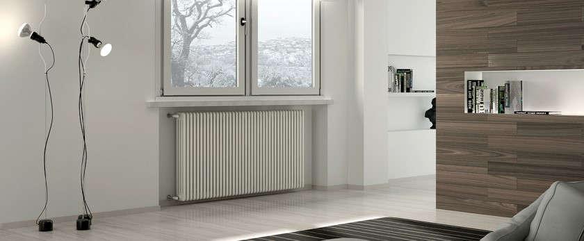 Как крепить радиатор к стене. Особенности монтажа чугунных стальных алюминиевых и биметаллических радиаторов