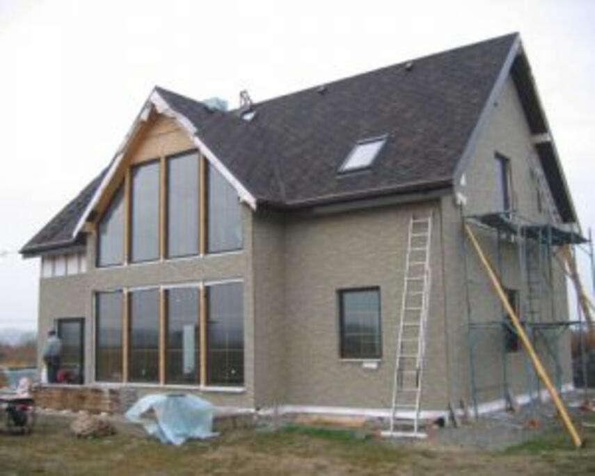 Каркасный дом для постоянного проживания, преимущества